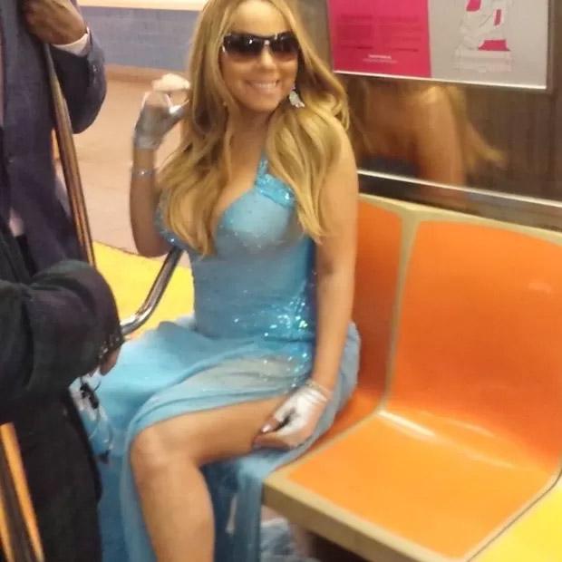 Com roupa de gala, Mariah Carey viaja de metrô na madrugada,
