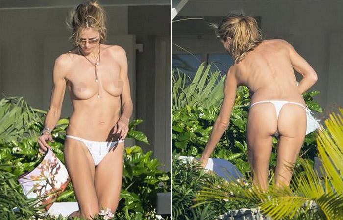 Heidi Klum faz topless e mostra tudo em praia de St. Barths