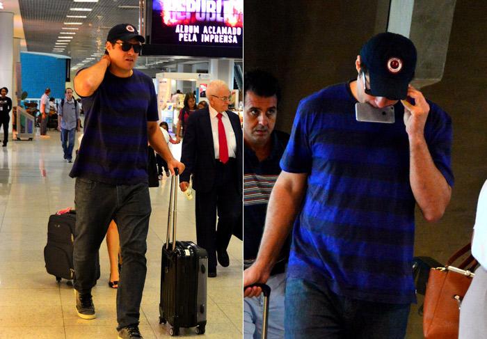 Ops... Thiago Lacerda segura celular com a boca para ajeitar os óculos em aeroporto carioca