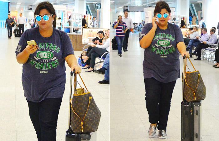 Fabiana Karla chama atenção com óculos escuros diferentes para embarcar no Rio