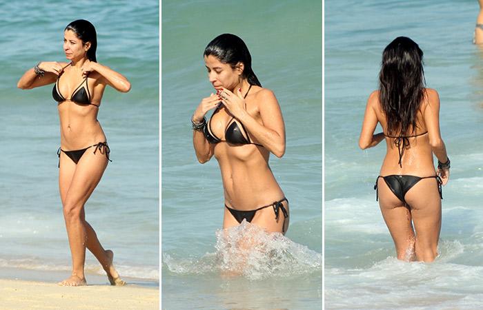 Anna Lima atrai olhares na praia do Leblon