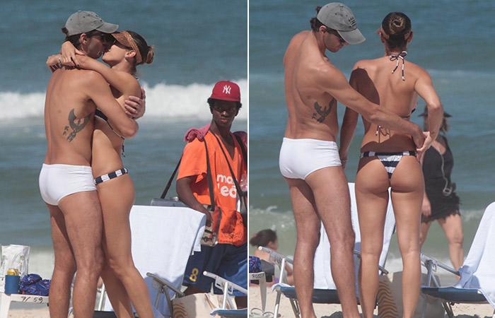 Giba confere biquíni da mulher em dia de praia no Rio