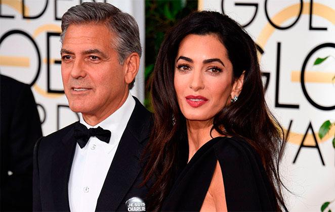 Amal Clooney e George Clooney em premiação