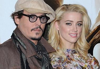 Johnny Depp e Amber Heard posam para as câmeras