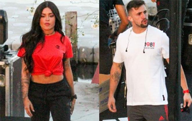 Aline Riscado está com camiseta vermelha com Arthur Picoli