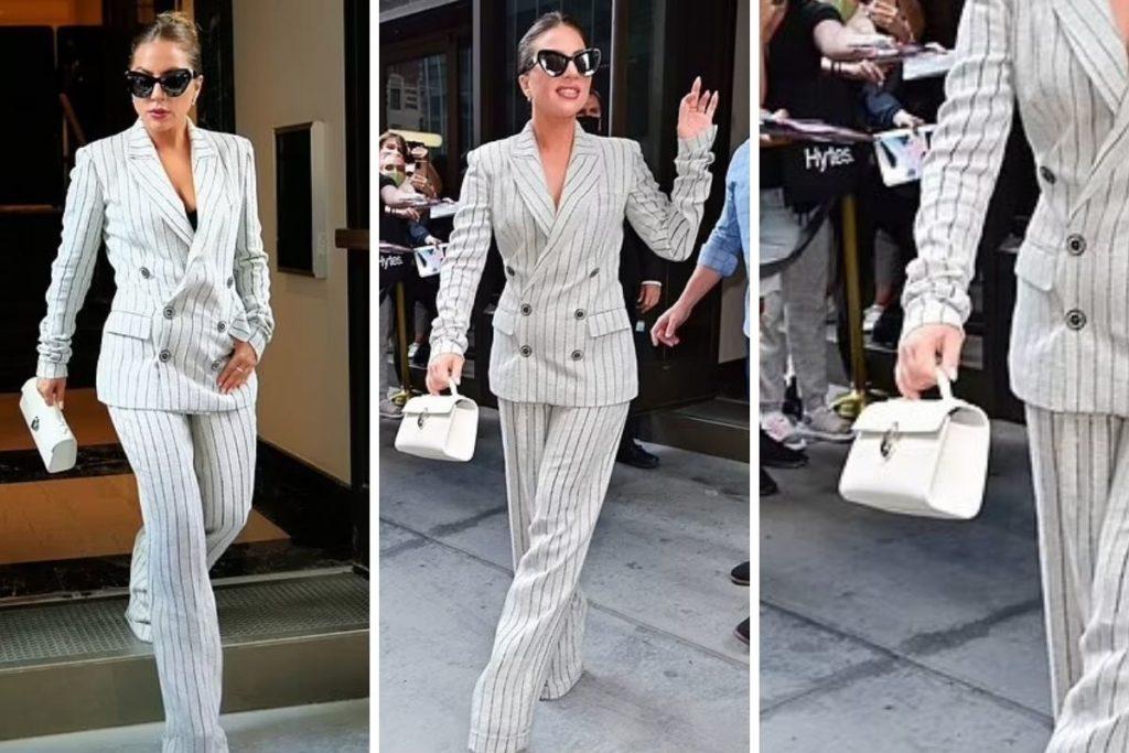 lady-Gaga-terno-risca-de-giz-branco-com-uma-bolsa-combinando-salto-alto-e-óculos-escuros-3